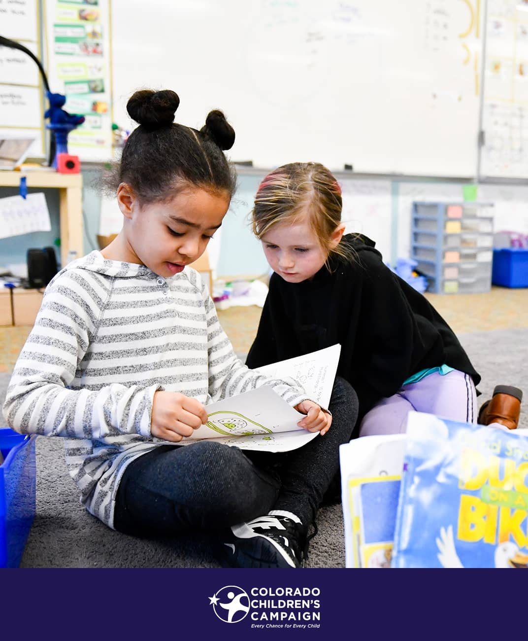Girls reading in school program for Colorado Children's Campaign