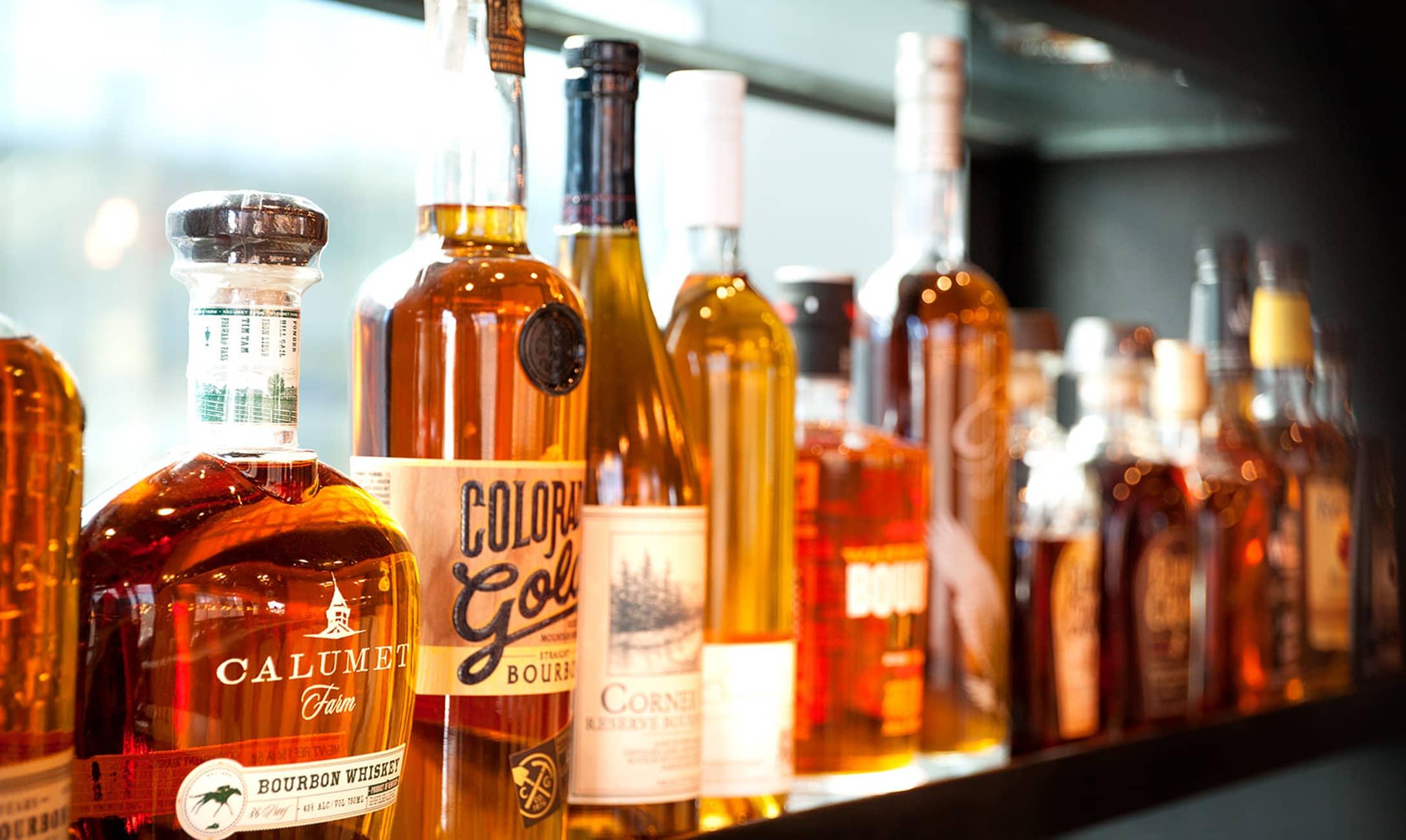Hearth & Dram whiskey bottles on shelf